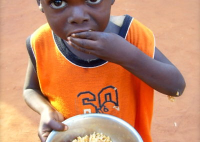 Small child eating, Togo, 09_2